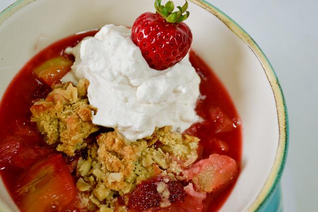 Bowl of baked strawberry rhubarb crisp