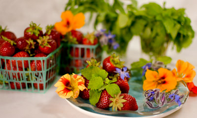 Strawberries and edible flowers